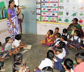 Women and children in a classroom