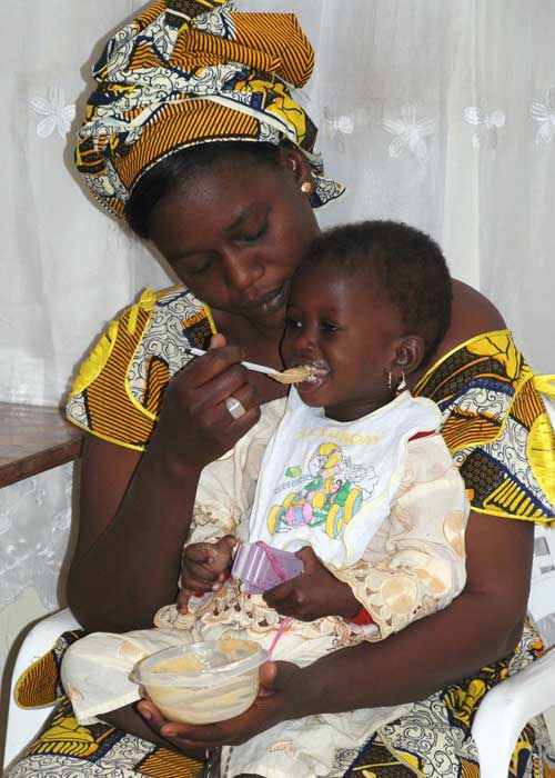 A mother feeding a child.