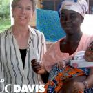 Distinguished Professor of Nutrition Dr. Kathryn Dewey (left) with mother & child from Burkina Faso